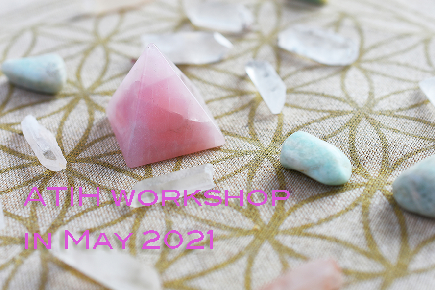 A close up image of a crystal self love energy healing grid using sacred geometry.
